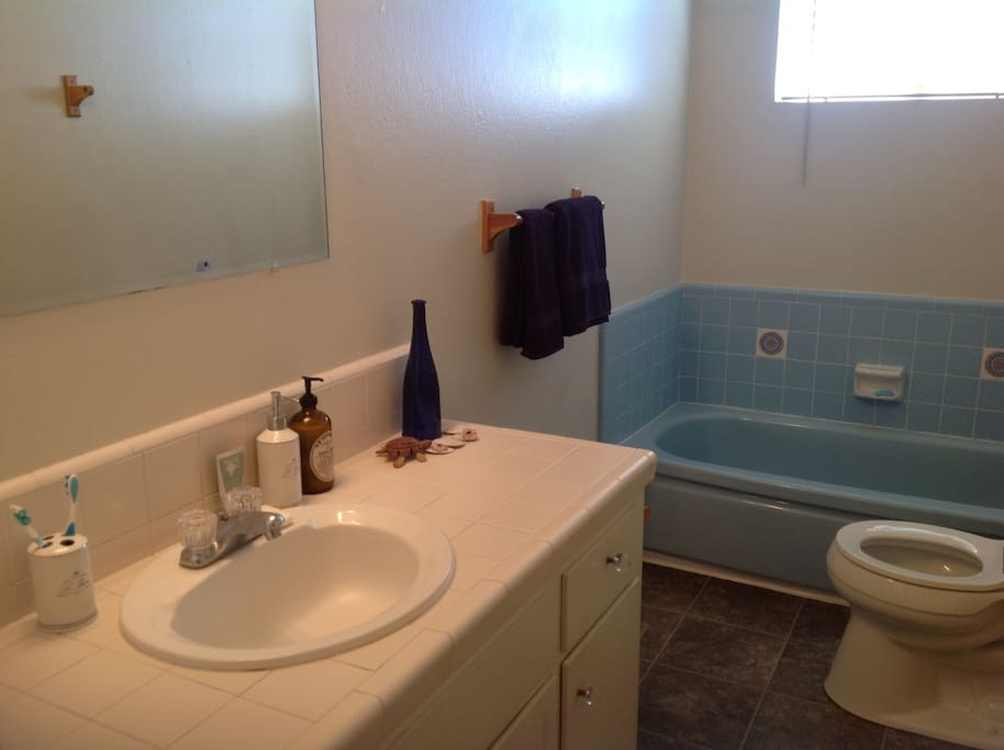Clean bathroom with sink, tub and shower