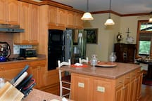 Stainless Steel appliances, an Island Bar and  Breakfast Nook