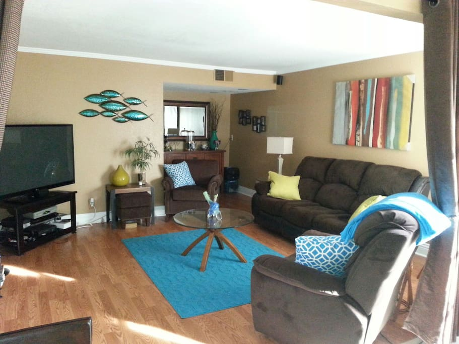 """Main living room with 65"""" LCD tv and HD cable and Xbox360."""