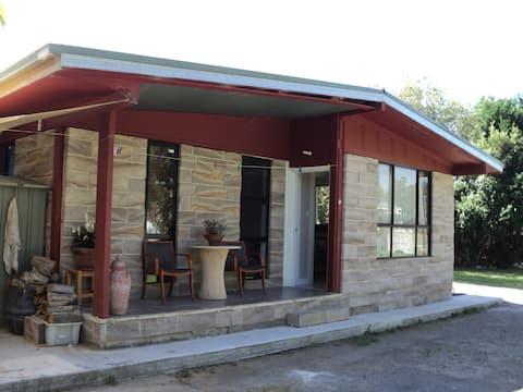 Sandstone cabin at rear of Motel