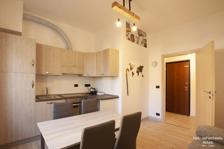 Area living con cucina e sala da pranzo/living room with kitchen and lunch room