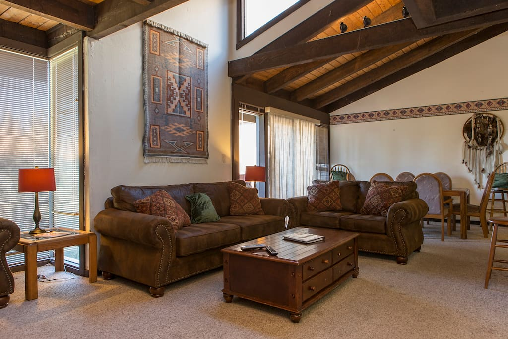Large living room sitting area with open vaulted ceiling.