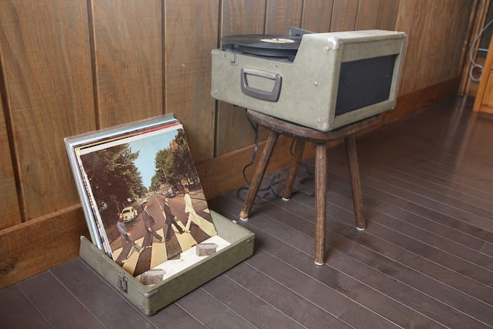 Vintage record player and an assortment of albums curated for relaxed vibes