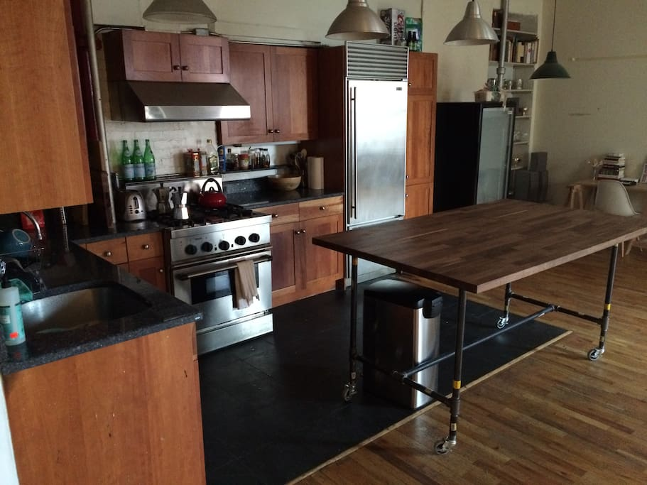 Kitchen - granite counters, butcher block island, professional range with hood, subzero fridge, dishwasher, slate floor. An inspiring place to cook.
