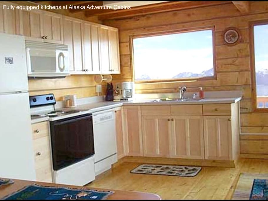 Fully equipped kitchen with plates and cooking utensils.