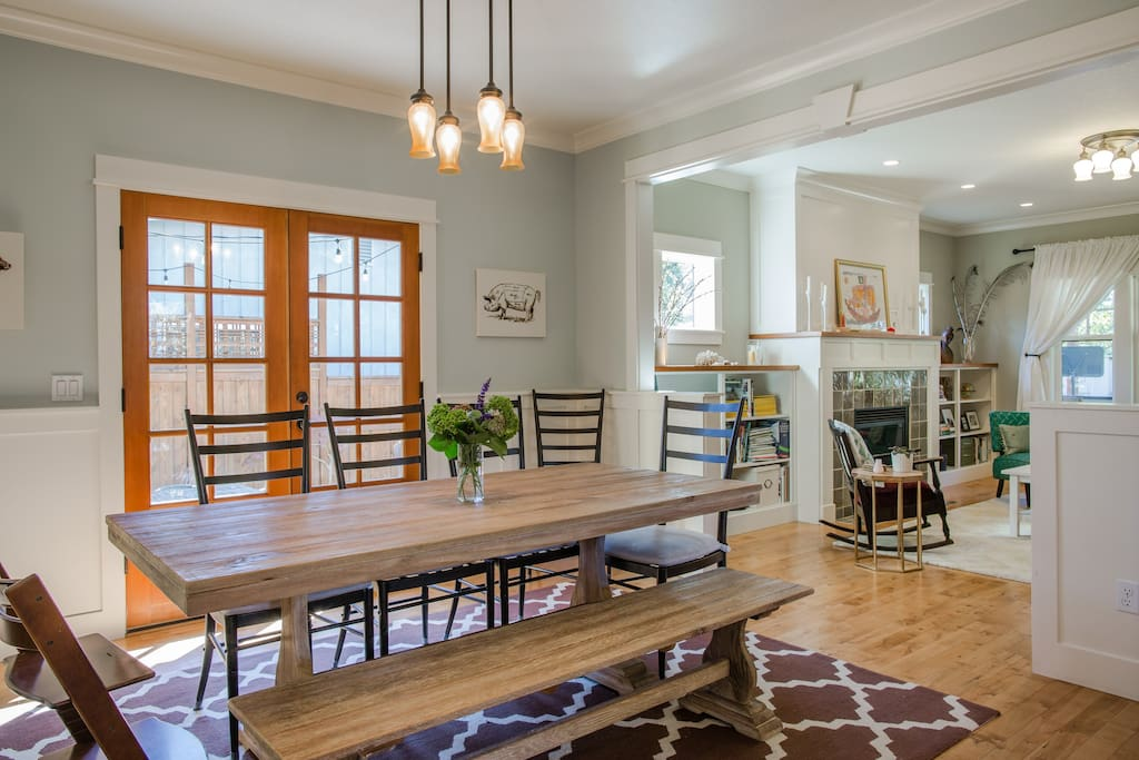 Dining room with French doors leading to outside patio and dining area.