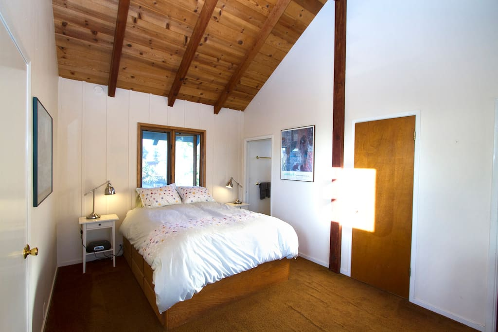 Lighthouse Queen bedroom with private bath overlooks the tree and rooftops
