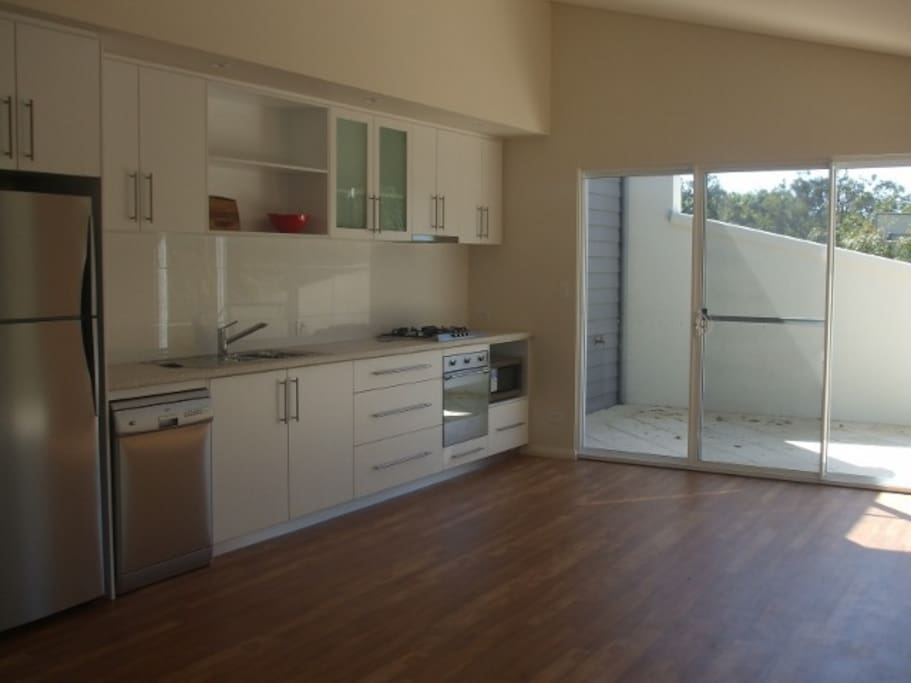 Galley style kitchen - outlook to private bbq area