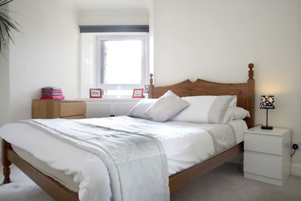 Large bedroom with kingsize bed and direct views to The Crags/Arthurs Seat