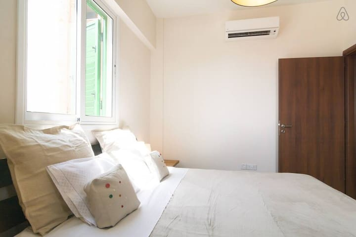 Master bedroom with comfortable King sized bed and A/C unit.