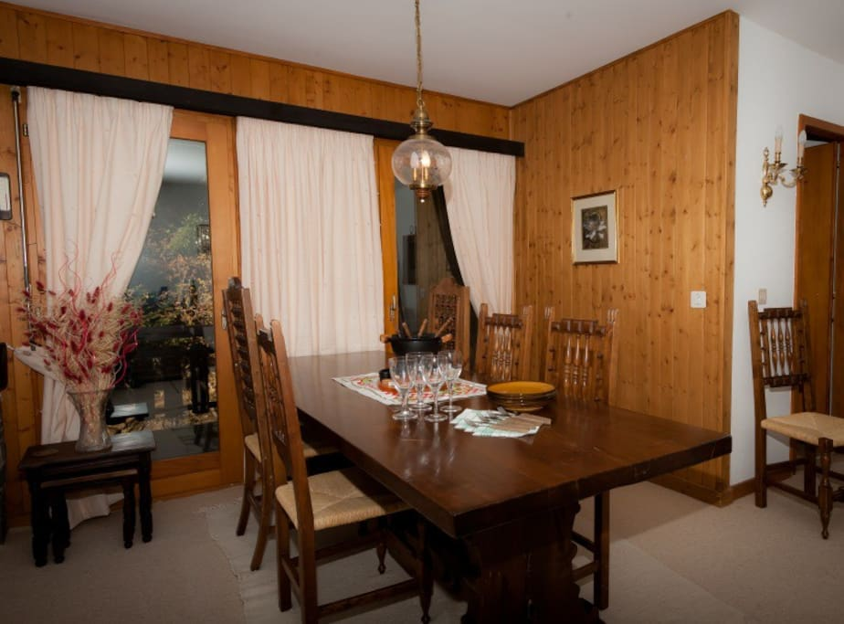 Dining area with large table which fits up to 10 people