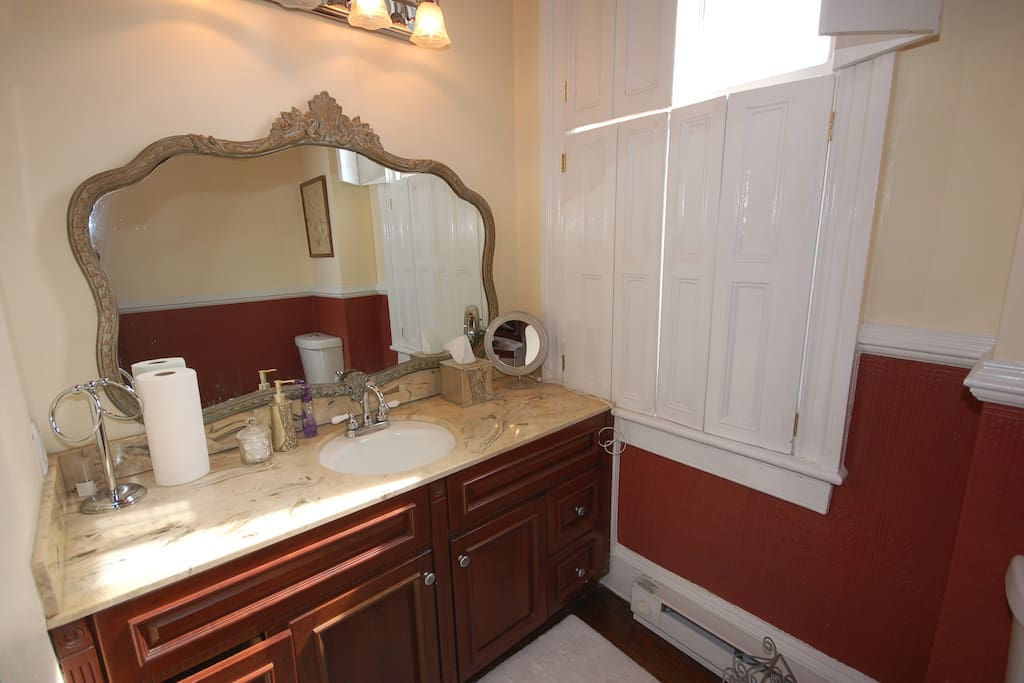 In keeping with the Victorian style of the house, the vanity is ornate with marble counter top