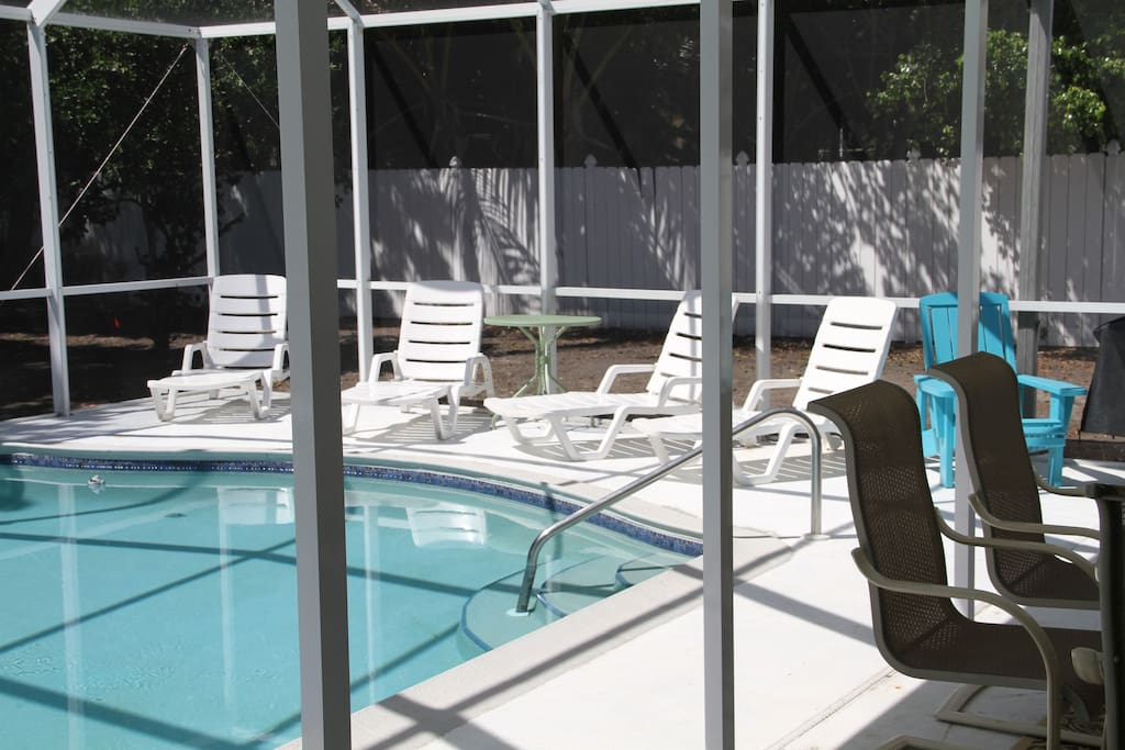 The large private sunny pool with plenty of seating and gas BBQ.