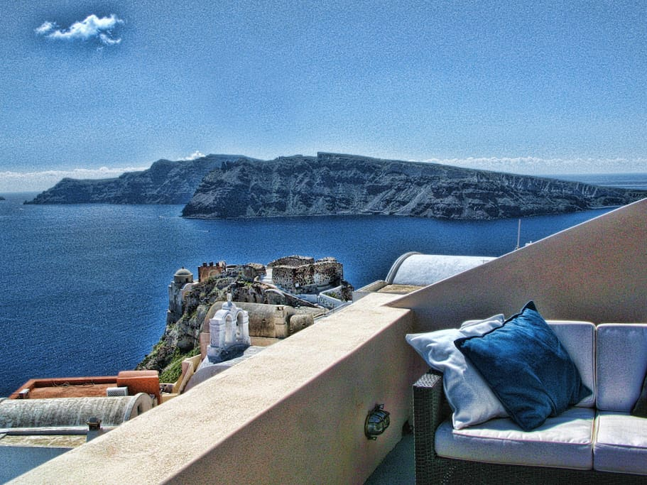 View of the island of Thirassia and the Old Oia Fortress from the Terrace!