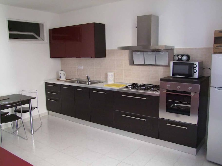 Kitchen with fan oven, gas hob sink & drainer Air con under the window