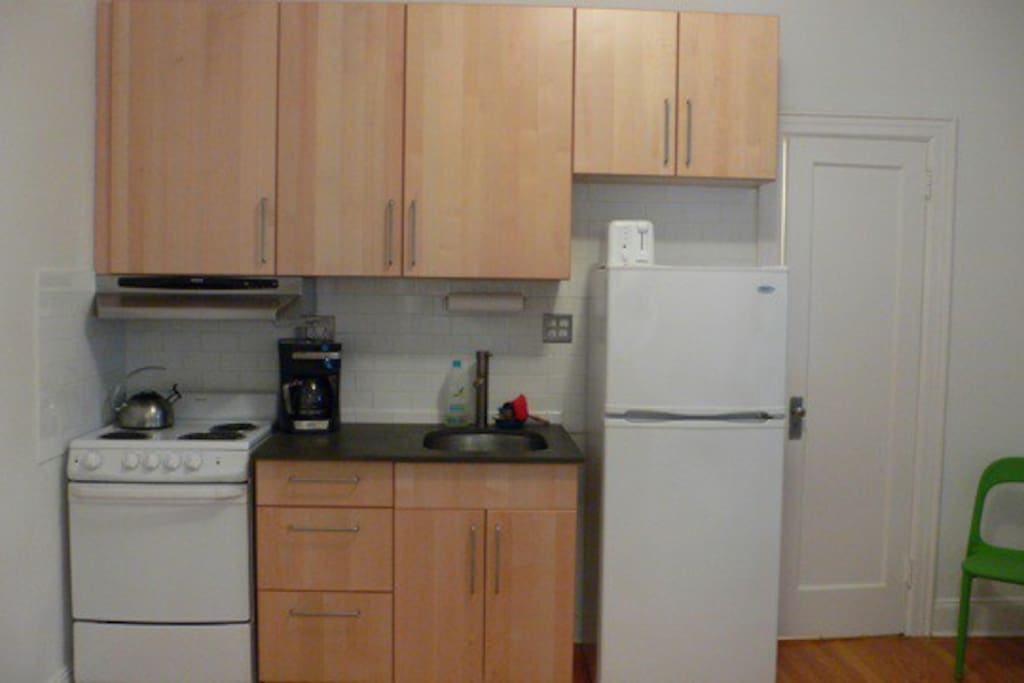 Kitchen with coffee and milk provided for your stay plus amazing fresh-baked donuts upon arrival.