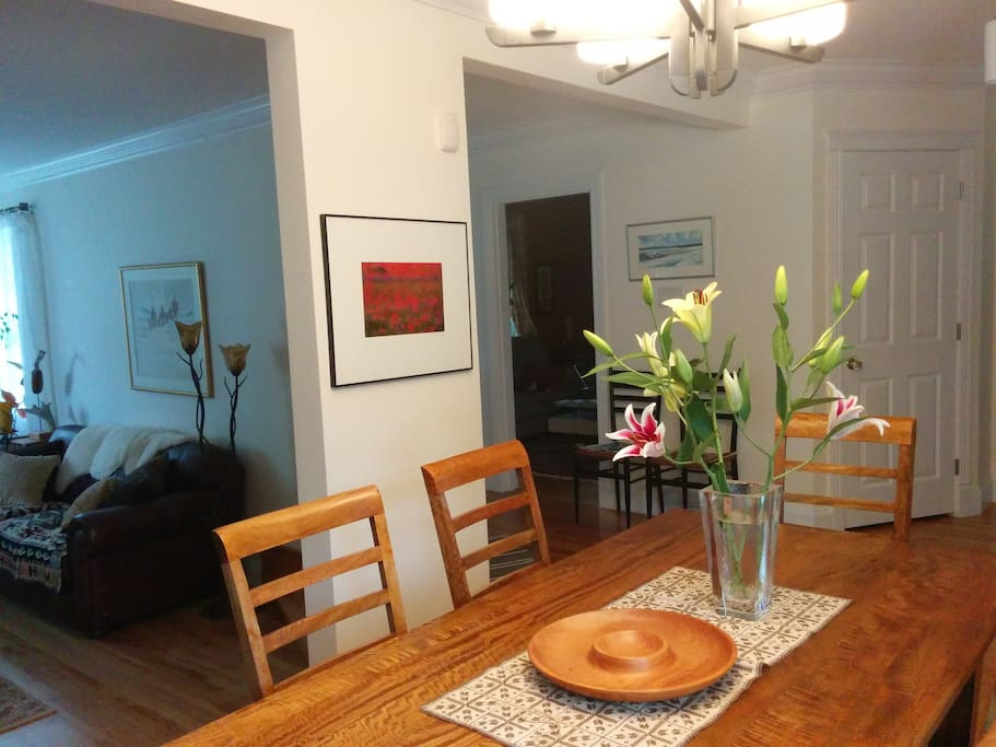 Dining room, great natural light, seats 6, handmade furniture, artwork, plants, access to back patio, kitchen, and living room. Mango wood table and chairs, treat with care.