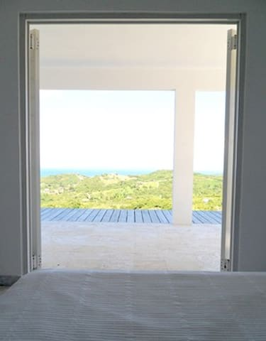 Good morning sunshine!   Open the double french doors of the master bedroom out onto the terrace.
