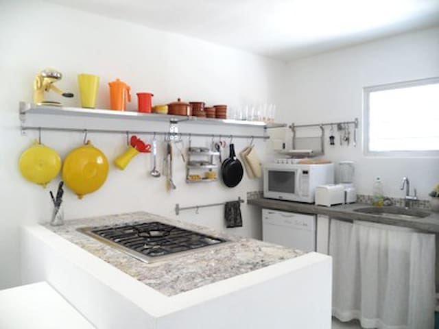Cooking Caribbean style in the well equipped chef's kitchen (gas cook top, convection/ microwave oven, blender, toaster).