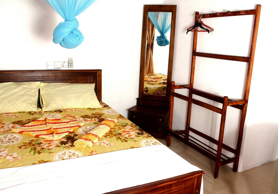 Double bed, mosquito net, Dressing table & cloth rack.