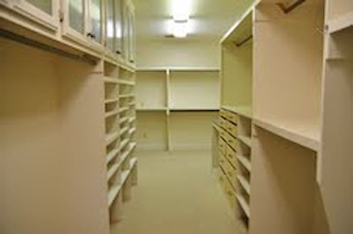 """The """"Live-in"""" closet features space for two twin (kids) beds."""