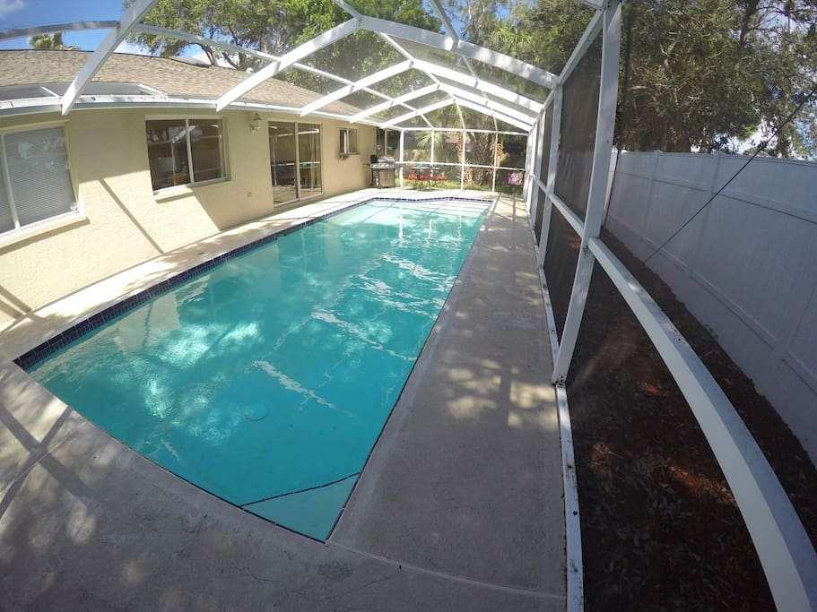 Screened in pool and patio area.