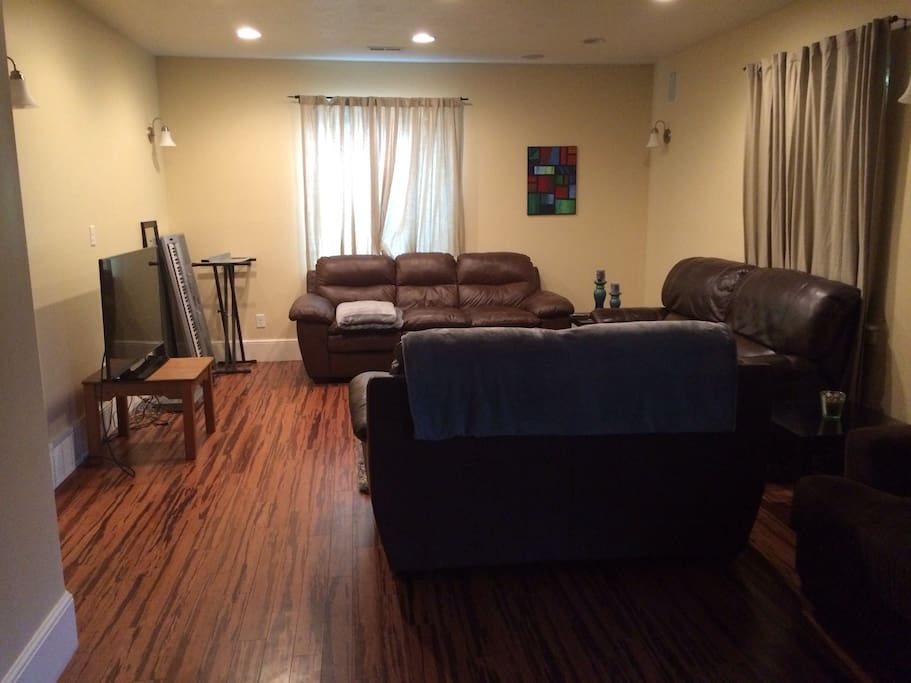 Comfortable living area with leather couches that recline for extra sleeping space