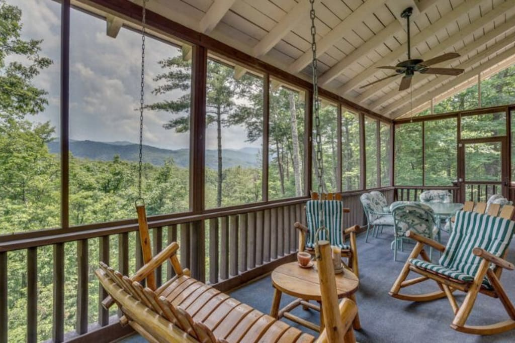 Back porch, screened in with outdoor dining table and lots of seating. We spend a lot of time in this room, the view is beautiful and the mountain air is so refreshing. Screened in porch to keep away the bugs. Love this room.