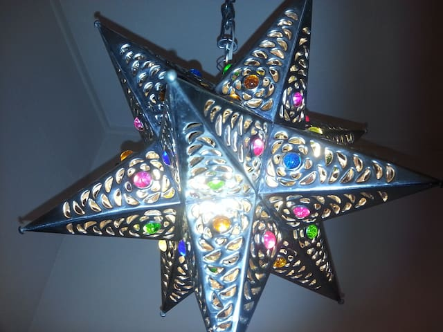 Handmade Mexican star light in the entry welcomes you.