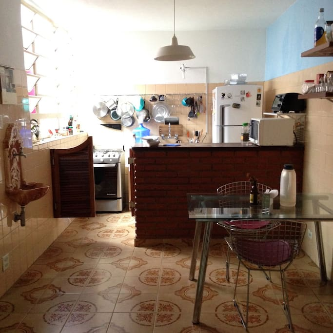 Kitchen has a gas stove w/ oven, refrigerator w/ freezer, toaster oven, blender, dinnerware and accessories.