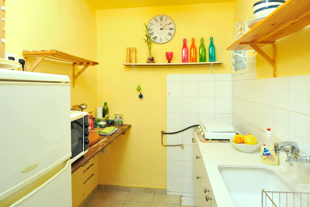 Bright kitchen with all cooking utensils provided.
