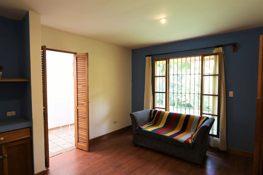 The master bedroom overlooks the gardens of the property,