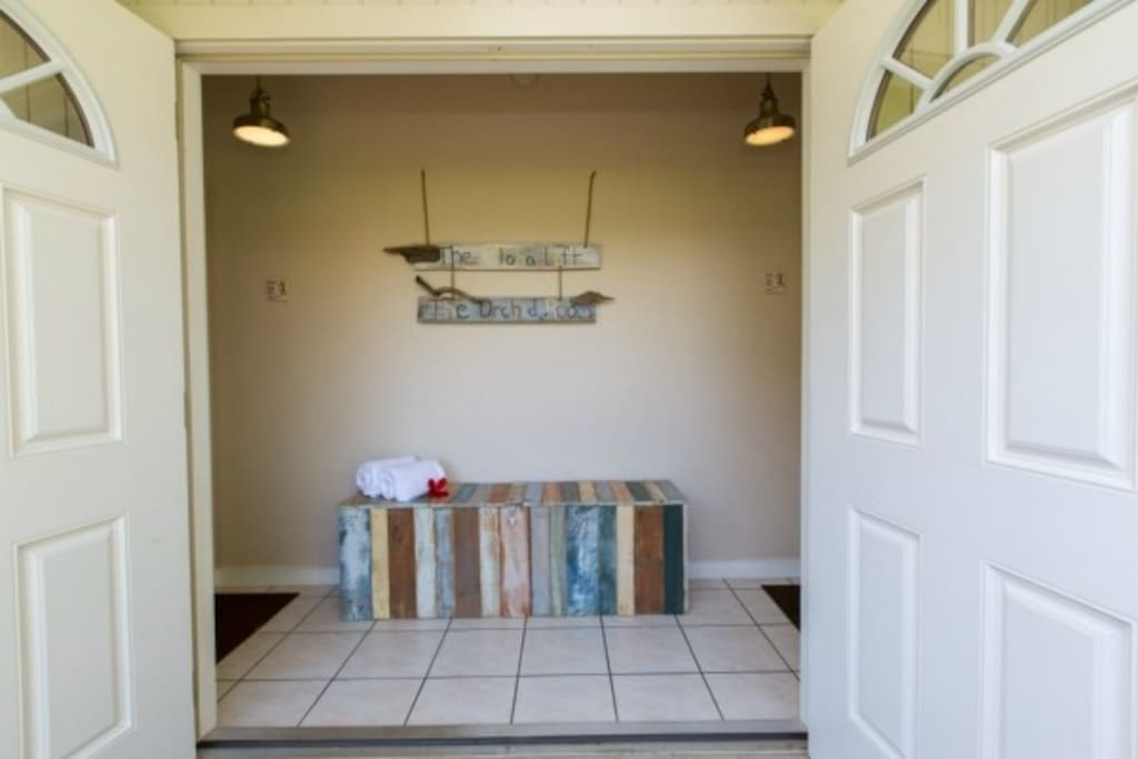 Foyer with double doors ~ to the right is Orchid Room