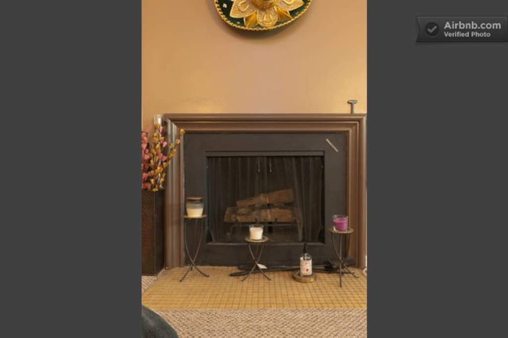 The fireplace adds coziness to the living room