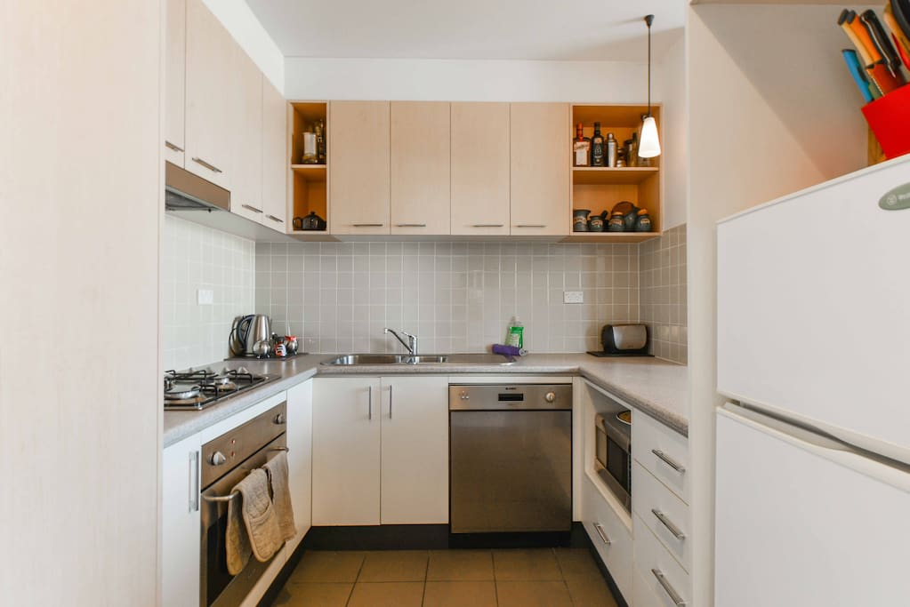 Kitchen with all modern apliances and Blanco quality dishwasher and over - its the kitchen of a home, not a hotel