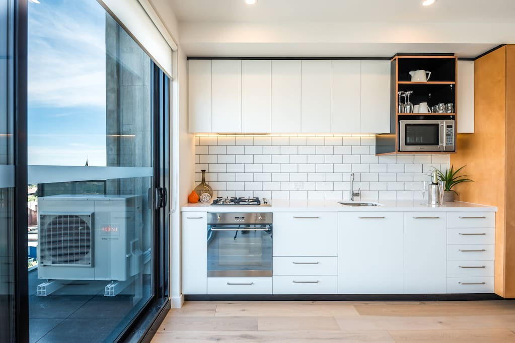 Enjoy the full kitchen including a Smeg oven, dish drawer and microwave