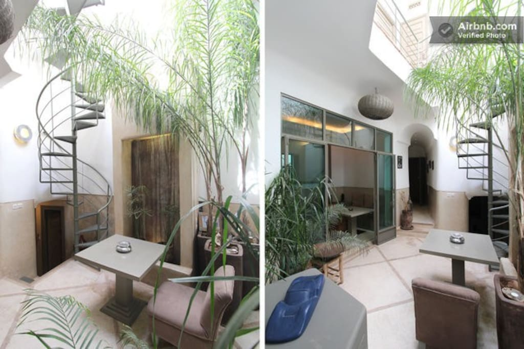 The central courtyard with view to the Riad's main entrance and the stairs down to the kitchen and hammam.