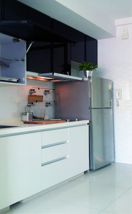 Fully equipped kitchen with microwave oven, bread toaster oven, electric kettle, pots and pans with complimentary snacks, coffee and tea. Washer cum dryer provided too.