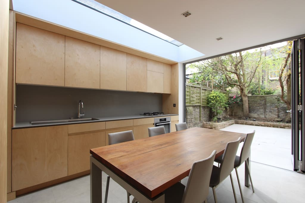 Kitchen/Dining and bi-fold doors that open to back patio