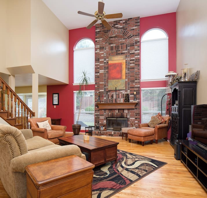 A great room family room Large comfy furniture, beautiful hardwood floors ~ all set with a fireplace backdrop. Gorgeous!