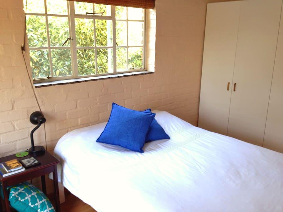 A bedroom furnished for understated sophistication.