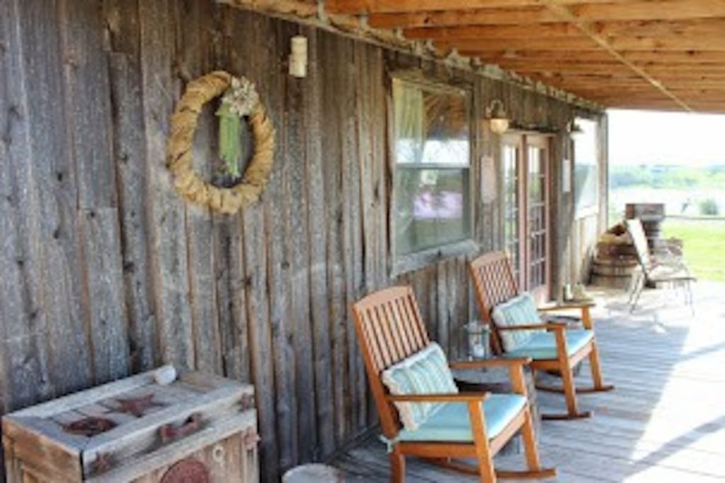 Saloon porch with rocking chairs.