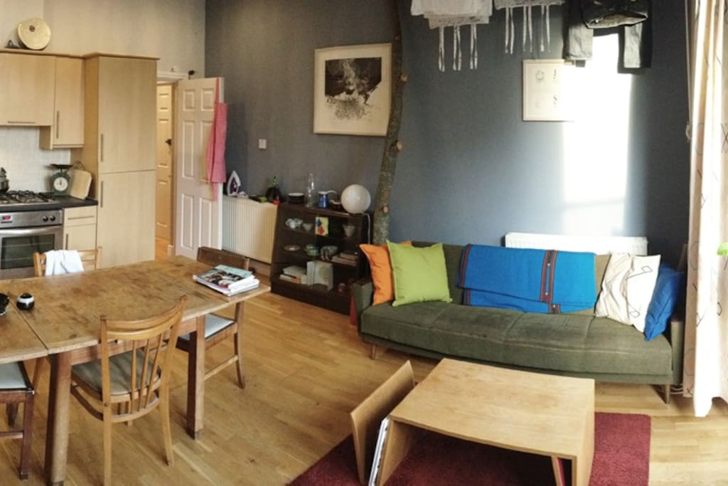 Panorama of living room looking towards kitchen