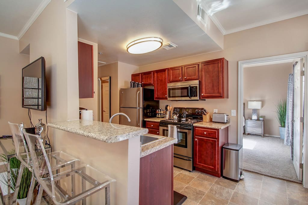 Beautiful modern kitchen with a bar table for two, covering all of your basic cooking needs.