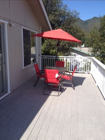 Large wrap around Trex Deck with outdoor Patio Table & Chairs