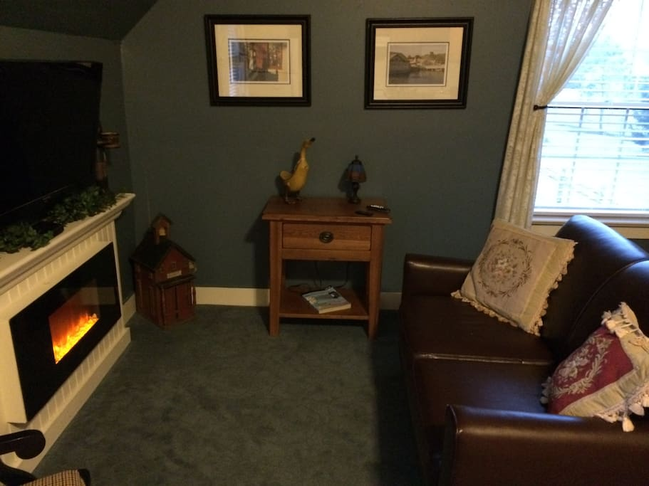 The Cottage has electric fireplace and full kitchen. It is a second floor studio apartment
