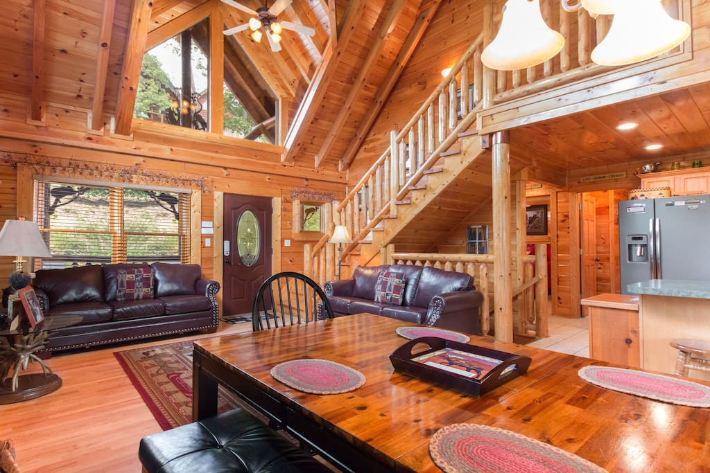 High cathedral ceilings and open staircase to master bedroom