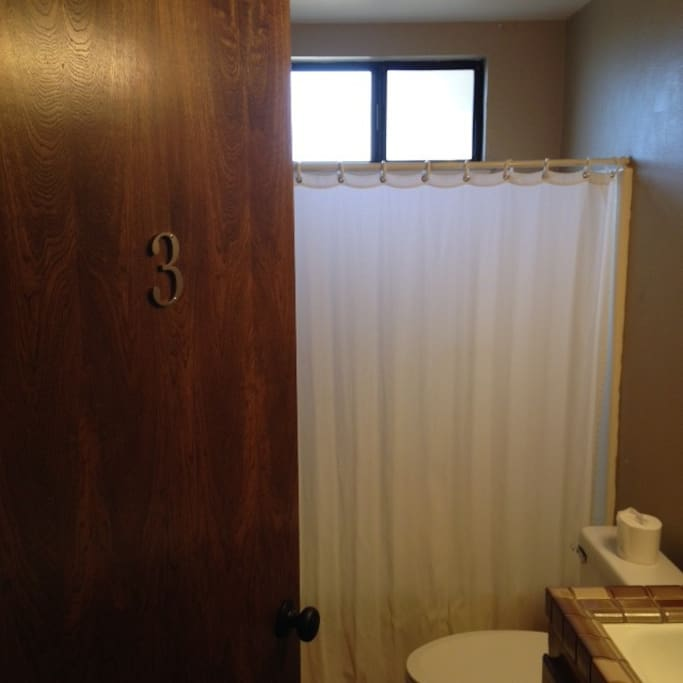 Private bath located just down the hall with tub/shower