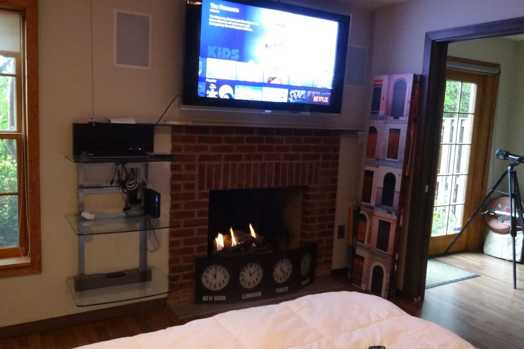 Watch movies and enjoy the warmth of the fire!