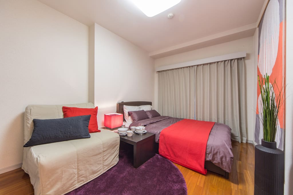 The room contains a double bed and a sofa bed.